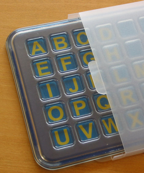 depressions in the FAB keypad 	 kept clean with polypropylene envelope